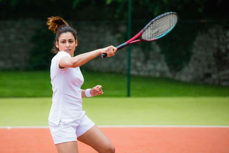 Woman Playing Tennis at the Brickway Club