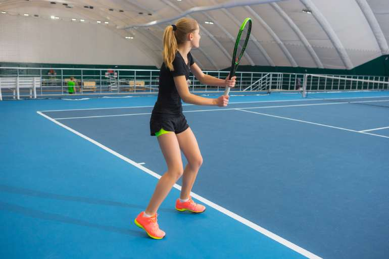 Member playing tennis at the Brickway Tennis and Pickleball Club